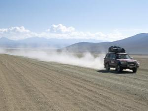 Land Cruiser on Altiplano Track and Tourists Going to Laguna Colorado, Southwest Highlands, Bolivia by Tony Waltham