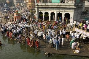 Worshippers at the Ramkund Tank on the Ghats Along the Holy River Godavari by Tony Waltham