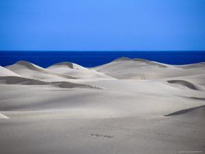 Gran Canaria Sand Dunes with Ocean in Distance, Maspalomas, Canary Islands, Spain by Tony Wheeler