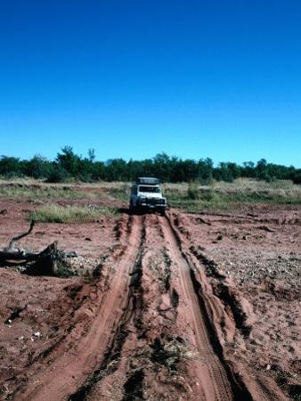 Landrover Driving Over Dry River Bed, Matusadona National Park, Mashonaland West, Zimbabwe