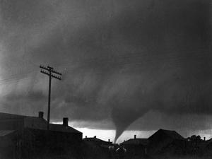 Tornado Moving Past Houses