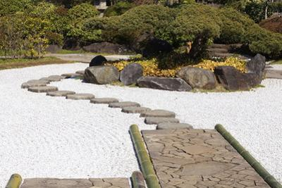 Zen Stone Path in a Japanese Garden by Torsakarin