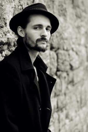 Close Up of Young Male Figure Wearing Black Jacket and Hat with Beard