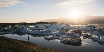 https://imgc.allpostersimages.com/img/posters/tourist-at-jokulsarlon-glacier-lagoon-at-sunset-south-east-iceland-iceland-polar-regions_u-L-Q12SE240.jpg?p=0