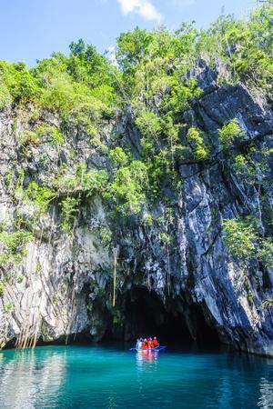 https://imgc.allpostersimages.com/img/posters/tourist-entering-a-little-rowboat-puerto-princessa-underground-river-palawan-philippines_u-L-Q12T76R0.jpg?p=0