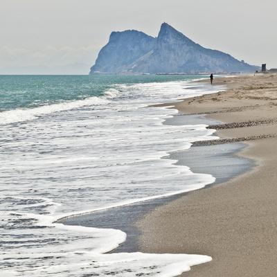 https://imgc.allpostersimages.com/img/posters/tourist-walking-toward-gibraltar-alcaidesa-beach-near-sotogrande-andalucia-spain-europe_u-L-PHCH9P0.jpg?p=0