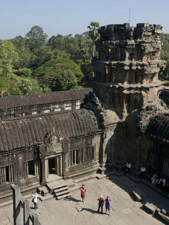https://imgc.allpostersimages.com/img/posters/tourists-at-the-angkor-wat-archaeological-park-siem-reap-cambodia-indochina-southeast-asia_u-L-PWFIM10.jpg?p=0