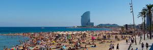 Tourists on the Beach with W Barcelona Hotel in the Background, Barceloneta Beach, Barcelona