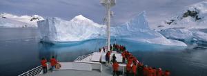 Tourists Standing on a Cruise Ship Watching at Iceberg, Antarctic Peninsula, Antarctica