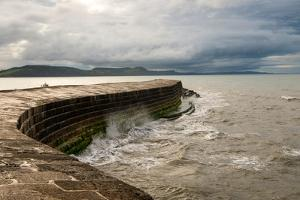A Stormy Day at the Cobb in Lyme Regis in Dorset, England UK by Tracey Whitefoot