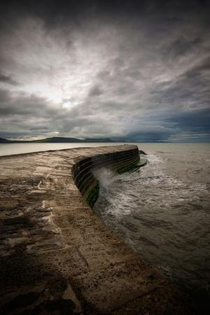 A Stormy Day on the Cobb at Lyme Regis in Dorset, England UK