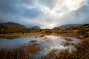 Dramatic Light Reflected in a Small Lochan at Sligachan, Isle of Skye Scotland UK by Tracey Whitefoot