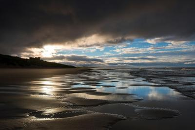 Dramatic Sunset Light on the Beach at Bamburgh, Northumberland England UK by Tracey Whitefoot