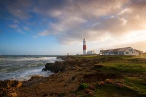 Sunset at Portland Bill in Dorset, England UK by Tracey Whitefoot