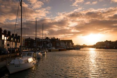 Sunset in the Harbour at Weymouth, Dorset England UK