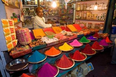 Trader on Colourful Market Stall (Selling Pigments and Kumkum Powder, Incense, Oil Lamps Etc. for…