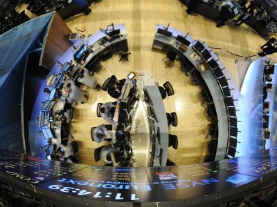 https://imgc.allpostersimages.com/img/posters/traders-work-in-one-of-the-new-trading-areas-on-the-floor-of-the-new-york-stock-exchange_u-L-Q10OQ7L0.jpg?p=0