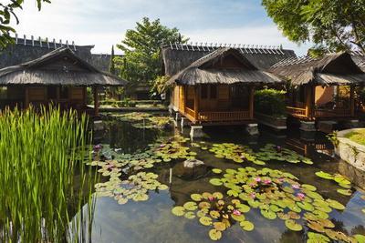 https://imgc.allpostersimages.com/img/posters/traditional-kampung-style-rooms-over-carp-ponds-at-the-kampung-sumber-alam-hot-springs-hotel_u-L-PQ8MCB0.jpg?p=0