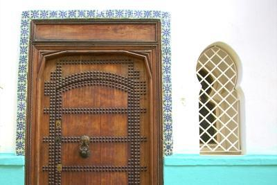 https://imgc.allpostersimages.com/img/posters/traditional-moroccan-decorative-wooden-door-tangier-morocco-north-africa-africa_u-L-PWFK330.jpg?p=0