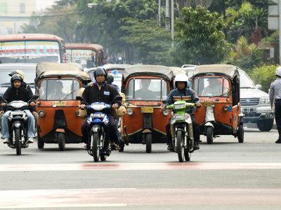 https://imgc.allpostersimages.com/img/posters/traffic-including-tuk-tuk-or-bajaj-jakarta-java-indonesia-southeast-asia_u-L-P7X6ES0.jpg?p=0