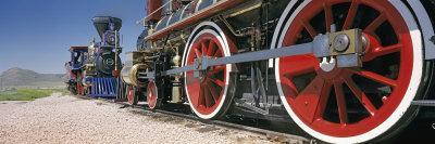https://imgc.allpostersimages.com/img/posters/train-engine-on-a-railroad-track-golden-spike-national-historic-site-utah-usa_u-L-P199H60.jpg?p=0