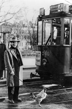 Tram Streetca in the 40's in Holland and a Man Out for a Walk with His Rooster