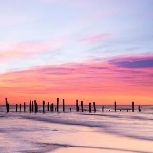Old Sea Defences at Dawn, Smooth Water from Long Exposure by Travellinglight