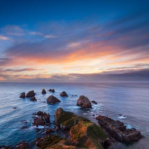 Rocks and Sea Stacks at Nugget Point Otago New Zealand, Sunrise by Travellinglight