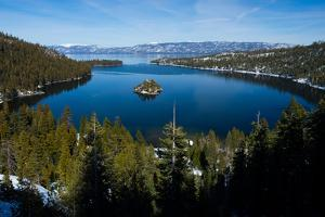 Trees at Lakeshore with Mountain Range in the Background, Lake Tahoe, California, USA