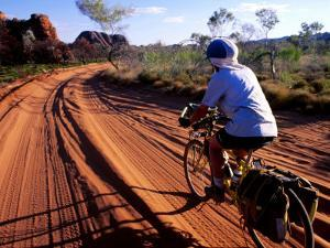 Cyclist on Outback Road, Purnululu National Park, Australia by Trevor Creighton