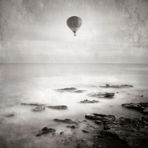 A Hot Air Balloon Floating Above the Sea by Trigger Image