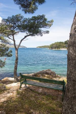 Croatia, Hvar Island, Stari Grad. Picturesque waterfront spot for bench.