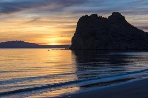 Mexico, Baja California Sur, Sea of Cortez, Loreto Bay. Kayakers past Nopolo Rock at sunrise. by Trish Drury