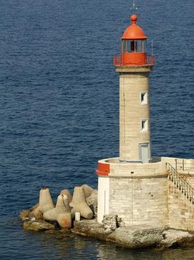 Port Lighthouse Guards Entrance to Harbor, Bastia, Corsica, France by Trish Drury