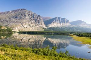 USA, Montana, Glacier Mountains Reflected on Lake Sherbourne by Trish Drury