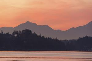 USA, Washington State. Olympic Mountains silhouetted in dramatic light. Calm Puget Sound. by Trish Drury