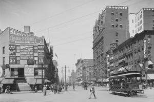 Trolleys and Pedestrians on Main Street in Buffalo, New York