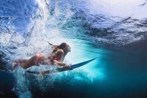 Underwater Photo of Girl with Board Dive under Ocean Wave by Tropical studio