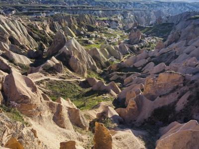 https://imgc.allpostersimages.com/img/posters/tuff-stone-erosion-in-the-rose-valley-close-gshreme-cappadocia-anatolia-turkey_u-L-Q11YR3N0.jpg?p=0