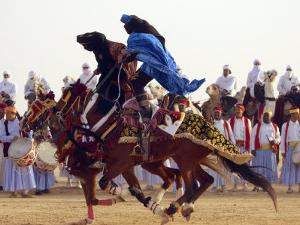 Tunisian Bedouins Demonstrate Their Riding Skills During the 36th Sahara Festival of Douz