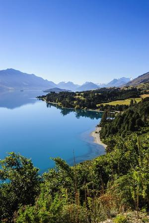 https://imgc.allpostersimages.com/img/posters/turquoise-water-of-lake-wakatipu-around-queenstown-otago-south-island-new-zealand-pacific_u-L-PQ8SYN0.jpg?p=0