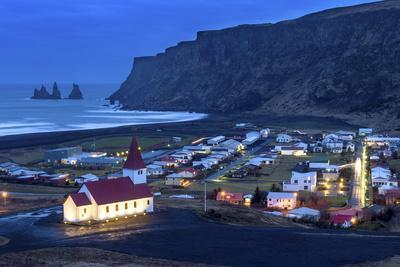 https://imgc.allpostersimages.com/img/posters/twilight-view-across-the-small-town-of-vik-south-iceland-iceland-polar-regions_u-L-PXXTJ30.jpg?artPerspective=n
