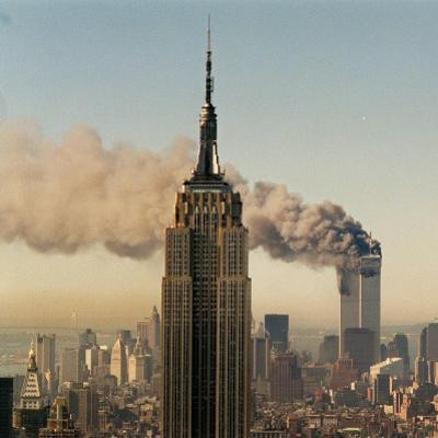 Twin Towers of the World Trade Center Burn Behind the Empire State Buildiing, September 11, 2001