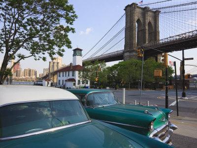 https://imgc.allpostersimages.com/img/posters/two-1950-s-cars-parked-near-the-brooklyn-bridge-at-fulton-ferry-landing-brooklyn_u-L-P91NHB0.jpg?p=0