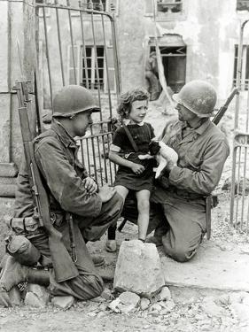 Two American Soldiers from the U.S. Corps of Engineers with a Little Girl and a Puppy