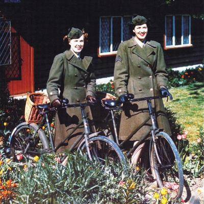Two American Women with Bicycles in Front of a House, Southern England, June 1944