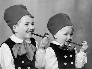 Two Brothers in Bavarian Costumes Pretend to Smoke Pipes, Ca. 1947