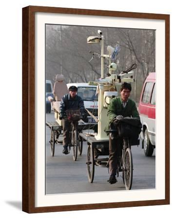 Two Delivery Riders Carry a Dentists Drill and Chair Along a Beijing Street January 4