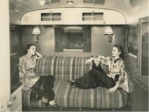 Two Dressed-Up Women in Trailer