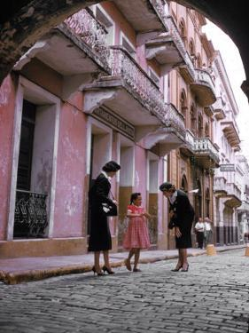 Two Eastern Airlines Stewardesses Talking to Native Girl on Street